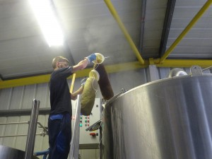 Our brewer Felix adding Seaweed to the boil